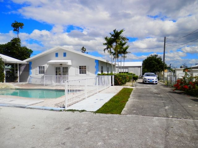 Commercial Opportunity in Freeport Bahamas!  Perfect Opportunity for a Business, Large Property Two Buildings Great LocationThe first building has a large open area two rooms a kitchen and bathroom. The roof is concrete, and has the second building is a warehouse metal building with a bathroom and kitchen.  #freeport #property #businessopportunity #realestate