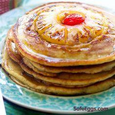 Pineapple Upside Down Pancakes. Ingredients: flour, baking powder, brown sugar, eggs, coconut milk, butter, vanilla, cinnamon, pineapple slices, cherries
