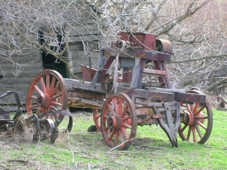 Old farm equipment and barn