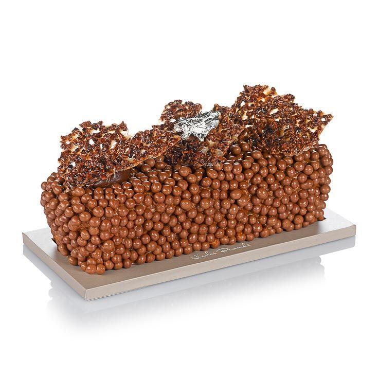 Le cake addictif à souhait! Autour de l'onctueux cœur mi-tendre mi-fondant, les billes de caviar chocolatées exhaltent l'envie irrépressible de le dévorer, sans en laisser un miette. Lire la Suite →