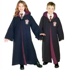 Your kids can join Gryffindor House for Halloween with a Kids' Harry Potter Gryffindor Robe Deluxe Costume. This kids' Halloween costumeconsists of a lightweight robe with a hood. The robe is decorated with the Gryffindor coat of arms. This kids' costume looks just like the Gryffindor robes in the Harry Potter films. Just add a white shirt, tie and black shoes to complete this easy Halloween costume.