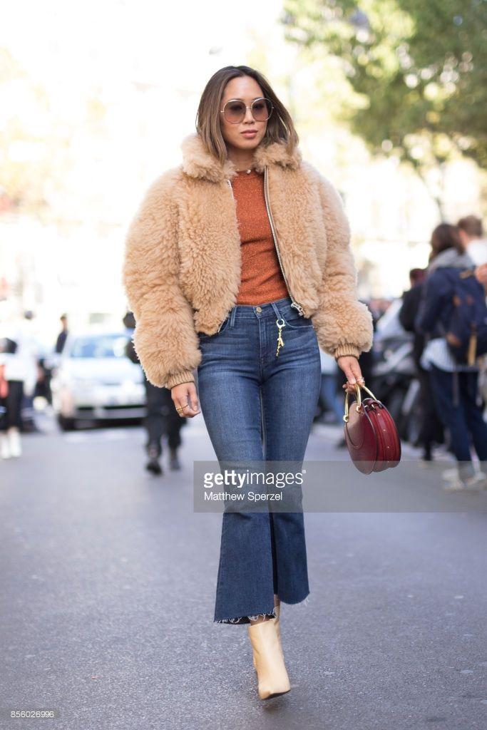 Aimee Song is seen attending Acne Studios during Paris Fashion Week wearing Acne Studios on September 30, 2017 in Paris, France.