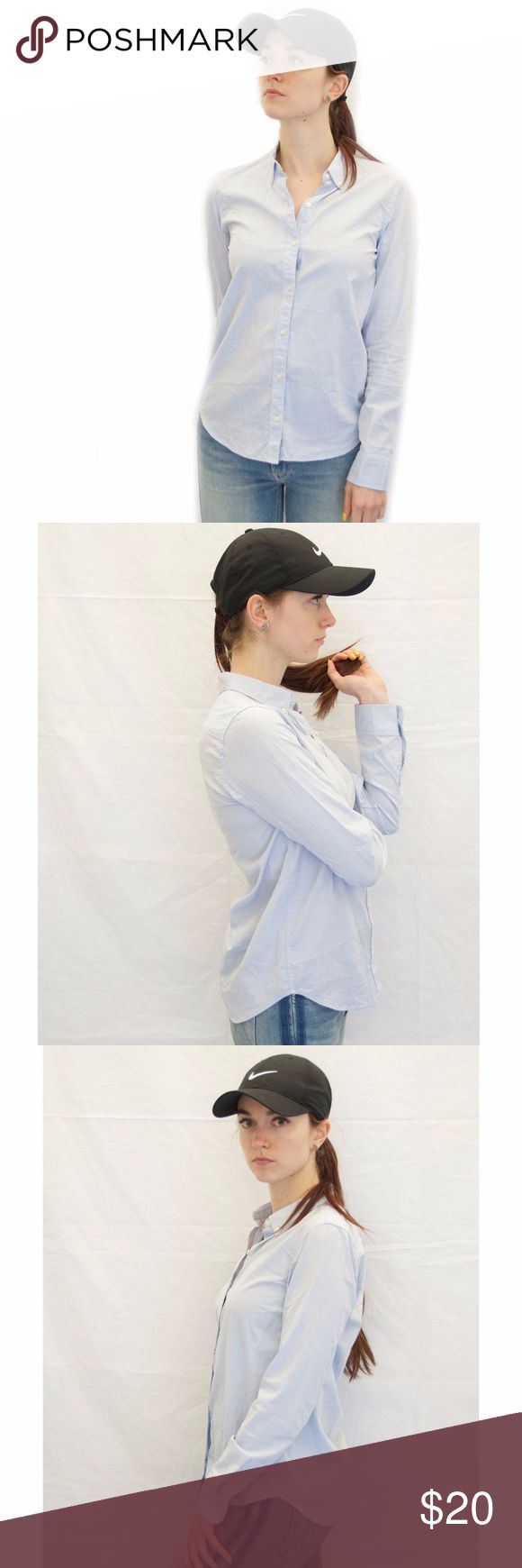 GAP Light Blue Button Down Oxford Shirt Great basic light blue oxford for women! In excellent preowned condition, with no sign of wear or defects. Fabric isn't too light nor too heavy; it has a nice weight to it. Feel free to make an offer :) GAP Tops Button Down Shirts