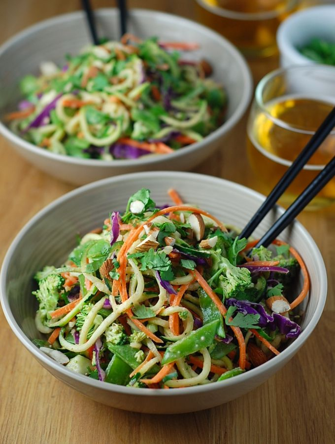 This healthy, no-cook raw pad Thai is made with zucchini noodles and topped with a spicy almond sauce. It's vegan, paleo, and gluten-free.