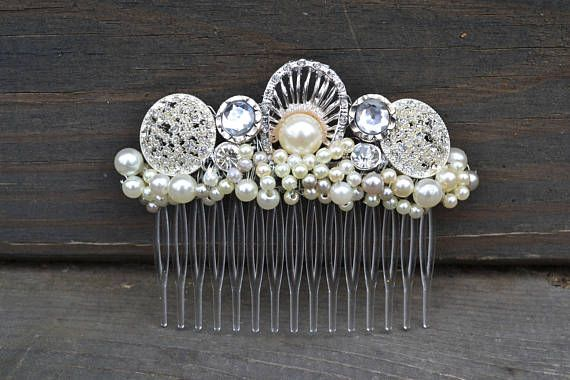 This elegant hair comb is perfect for any wedding, prom or formal event! It is silver and pearl colored and would be a great accessory for anyone look...