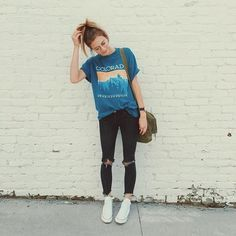 Loose blue graphic tee + ripped skinny black jeans + white converse + high pony + glasses  School outfit