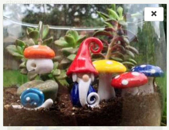 This charming starter kit contains all the décor you need to start your very fairy garden. Or makes the perfect addition to an exiting terrarium, or planter, adding a little bit of color and fun! They are hand sculpted from polymer clay, and finished with a high gloss glaze.  This listing includes: One Miniature Garden Gnome Three mushrooms (One Large, Two Small/Medium) all different colors One Miniature Birdhouse (or Gnat House as I like to call it) complete with Shepards Hook for hangi...