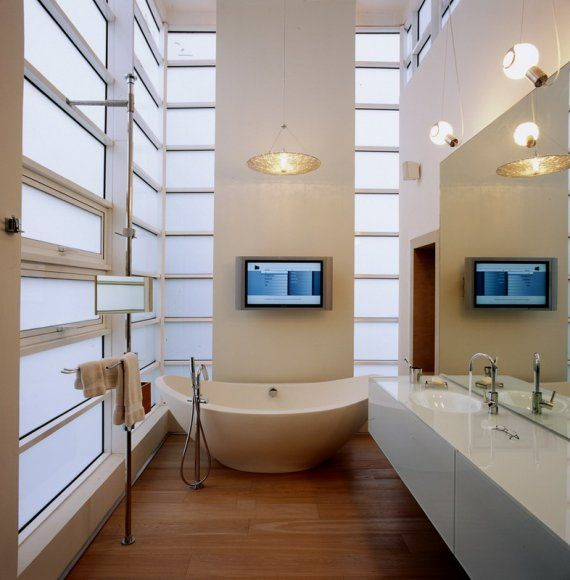 Technology and contemporary light are the features of this retreat. Large mirrors reflect light to balance this space.