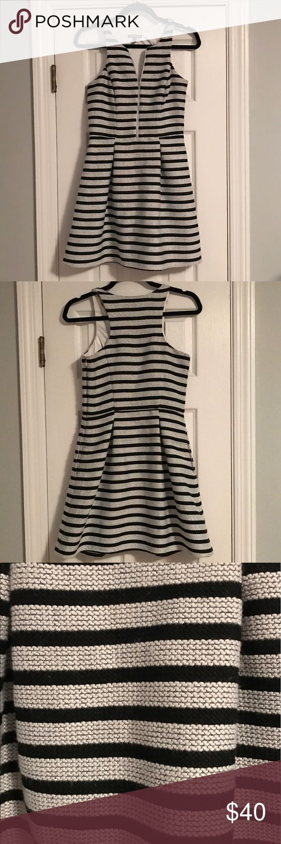 Business, professional dress Black and white striped dress. Adjustable zipper. Pockets!! Perfect for a business occasion. Perfect condition. Worn once. True to size Express Dresses Mini