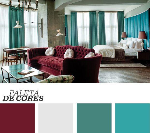 Combinar estilos na decoração dá muito certo! As paredes de concreto, com aspecto mais frio, são a opção perfeita para móveis e detalhes com curvas e cores sensuais, como o sofá bordô de velulo e o azul matte na cabeceira da cama. Veja mais ideias de decoração clicando na imagem!