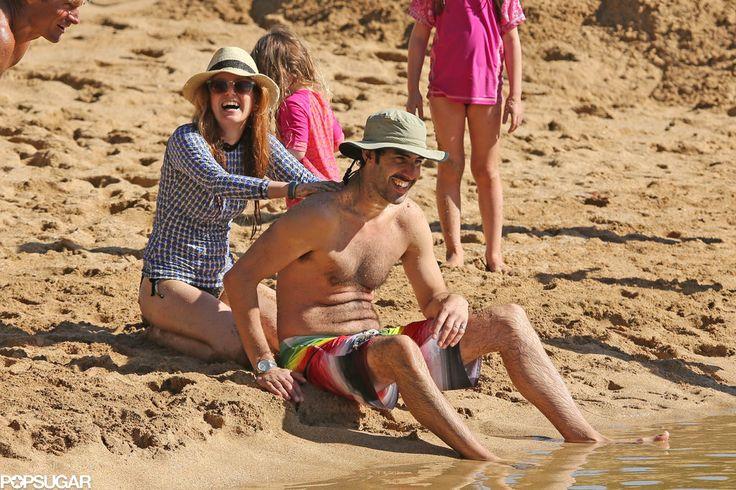 Isla Fisher and Sacha Baron Cohen show PDA in the Hawaiian sun!