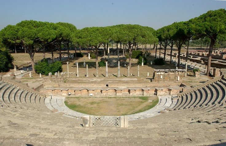 """The theater and adjoining four-sided colonnade (""""Square of the Corporations"""") at Ostia Antica, constructed in the late 1st century BC and modified several times through the 3rd century AD."""