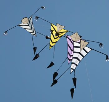 Blockhead Train - vaguely cute stylized figures fly in formation. Modern art in motion! T.P. (my-best-kite.com)