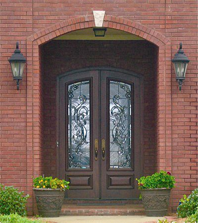 Pictured Is A Country French Exterior Wood Entry Consisting Of A Pair Of X  Style Doors Made Of Mahogany With Custom Leaded Beveled And Textured Glass.