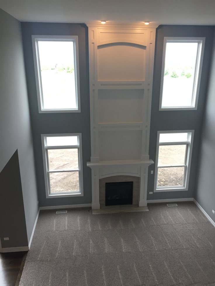 Family Room with two-story fireplace - King's Court Builders Coventry in Plainfield, IL