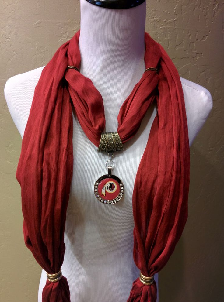 """The scarf is 72""""x24"""" and is made out of high quality Viscose. It is adorned with burnished gold colored accents, which match the Pendant. The Pendant is an extra large(1 and 3/4 """") This item is custom made and takes 24 hours. 
