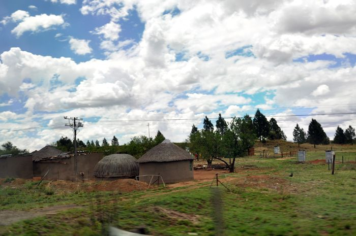 Rural houses around Babanango, KZN, South Africa. The rounded hut is a tradtional Zulu hut. (ACPhotography)