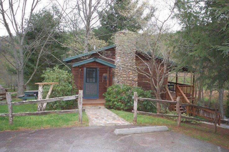 The hummingbird cabin is so cozy, you won't want to leave after you get settled in! #glamping #ashevillenc #cabin #serene