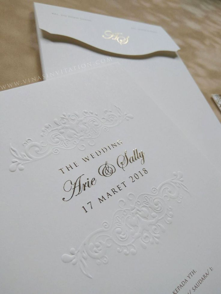 vinas invitation. sydney wedding invitation. indonesia wedding invitation. pure white. simple white invitation..gold font. gold emboss. any question please visit website www.vinasinvitation.com . courtesy of Arie & Sally