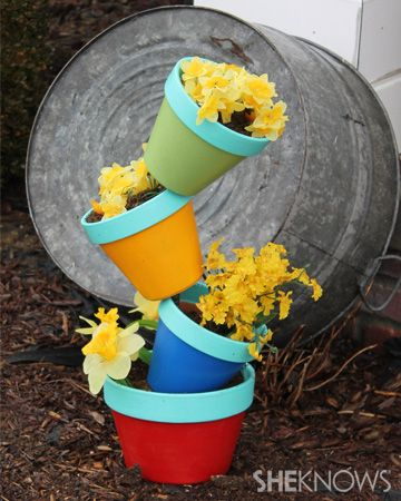 Create your own garden art! - Turn boring terracotta pots into unique and colorful garden art with just a few simple and inexpensive items.