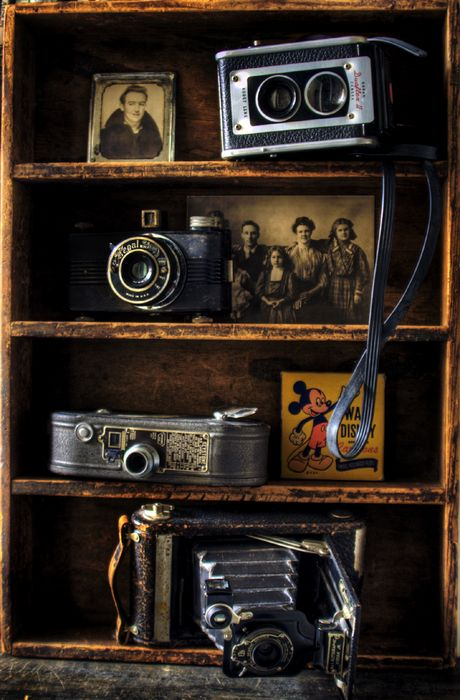 A very nice display of vintage cameras and photos