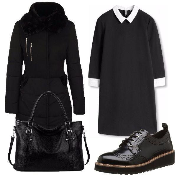 Cappotto nero bimateriale e con fodera, vestito nero con maniche a 3/4 e colletto e polsini simili a camicia, scarpe comode con lacci e borsa in pelle nera con tracolla rimovibile.