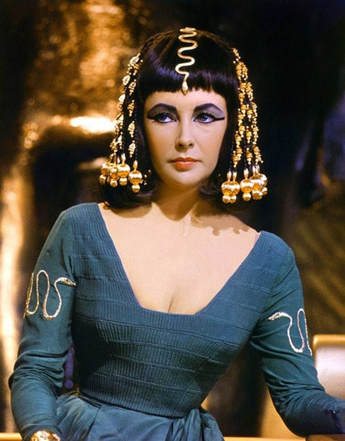 Elizabeth Taylor as Cleopatra in 1963. I love the color and neckline of this dress.