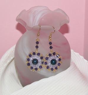 Orecchini con perle swarovsky,mezzi cristalli e bicono swarovsky