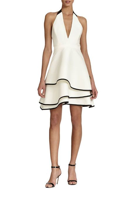 Brides.com: . Ruffled halter dress, $425, ABS available at Saks Fifth Avenue