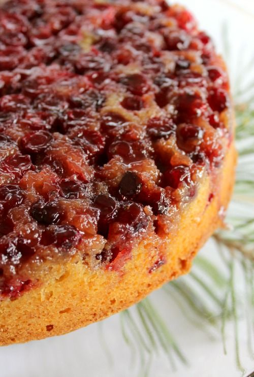 Cranberry Upside Down Cake. Cranberries, glazed on top of a golden cake infused with orange zest, cinnamon and ground ginger.