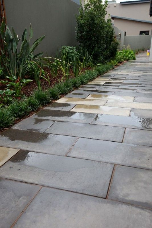 The Cosmopolitan Paver is a smooth, modern, rectangular paving slab.