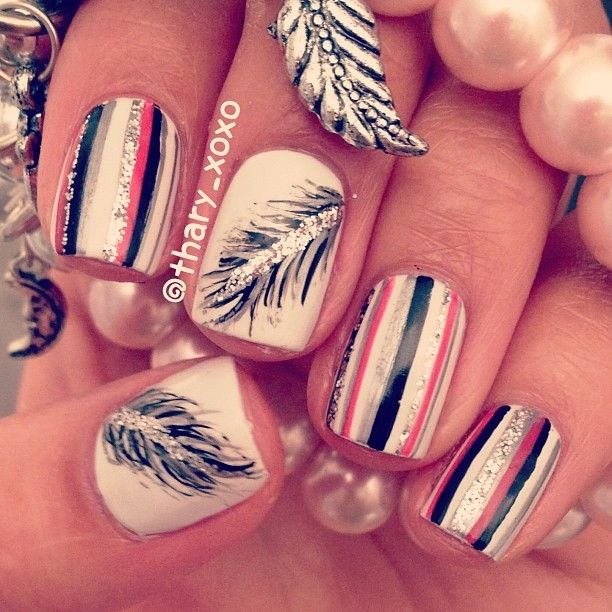 Pink and black striped nails with feather accent nail