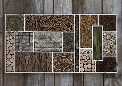 geometric wall art made with natural materials like bark, twigs & moss
