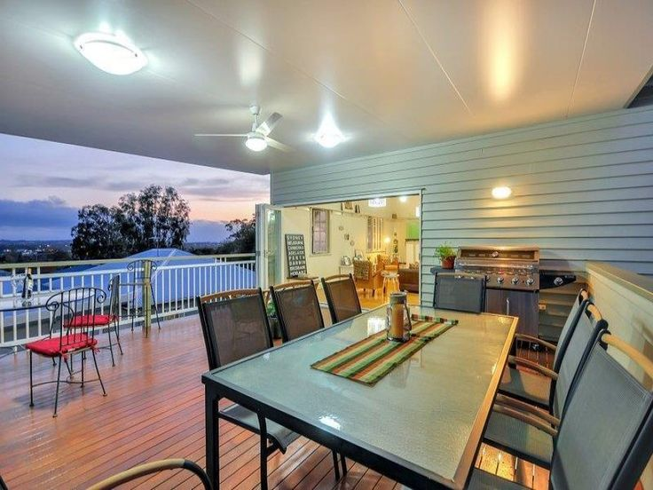 Renovated 1920's heritage listed Queenslander.  The best part of the house in my opinion.      Huge entertaining deck with million dollar views to the mountains.   The bi-fold doors are 3 meters wide which gives you an idea of the size of this great space.