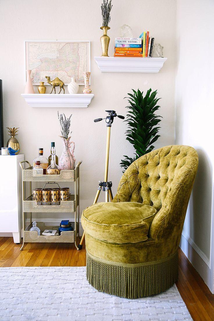 San Francisco Modern Vintage Home- a vintage corner with vases, brass camel. map and green tassel chair