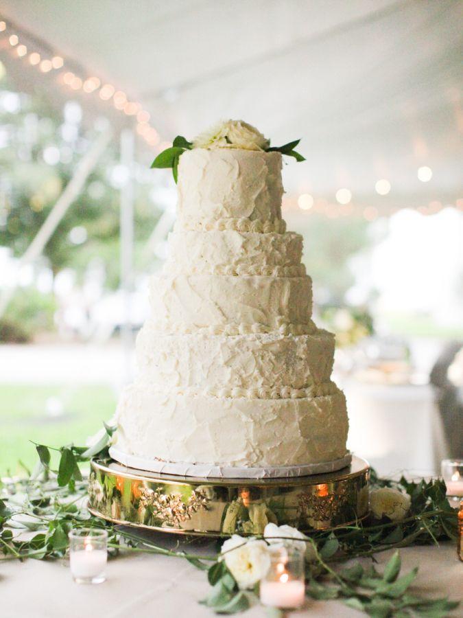 Towering buttercream frosted cake: http://www.stylemepretty.com/2016/06/21/former-miss-nebraska-usa-shares-her-hometown-wedding/   Photography: Megan Pomeroy Photography - http://meganpomeroyphotography.com/