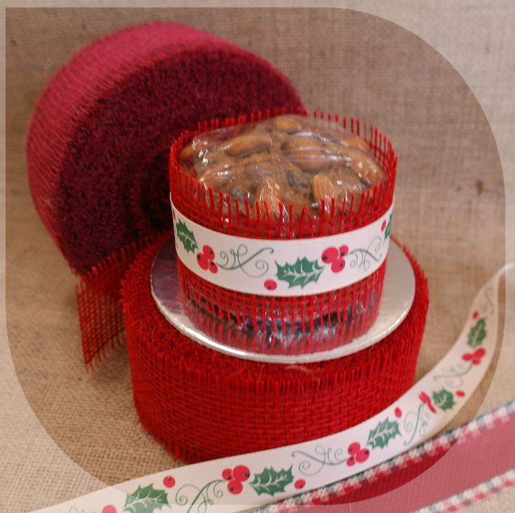 A simple way to present a Christmas cake. Hessian ribbon with an interesting ribbon over the top.