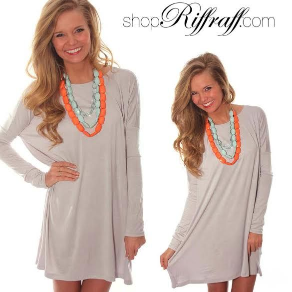 A swing dress is always great for hiding hips plus the statement necklace draws attention to your face