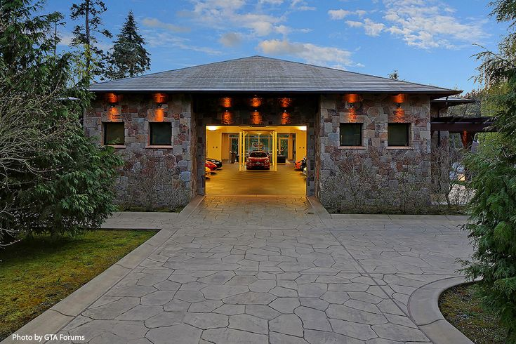 huge stone garage that houses up to 10 cars and a lift we. Black Bedroom Furniture Sets. Home Design Ideas