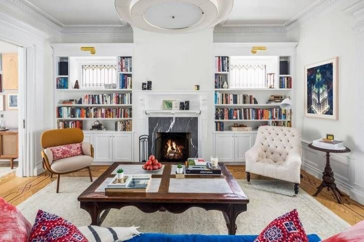 A sneak peek into the $8 million Brooklyn brownstone of celeb power couple John Krasinski and Emily Blunt. The front parlor is lit with natural light that streams through the bay windows.