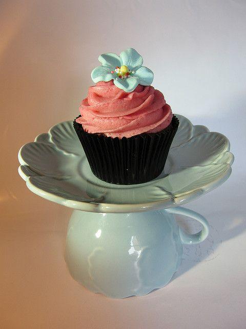 tea cup and saucer as a cake plate. cute idea.