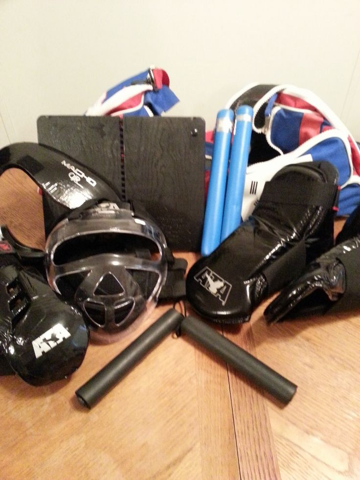 ATA Taekwondo Sparring Gear and Bag multiple items included. Sparring boots, sparring gloves, face shield, re-breakable board and 2 weapons. Every item is in very nice condition. Only used for a very short time. No rips or tears. Gloves Size adult medium Foot Pads Size adult 13