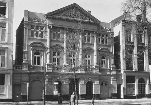 1962. View of the facade of the Hollandsche Schouwburg in Amsterdam. During the Nazi-occupation of Amsterdam the Hollandsche Schouwburg was used as an assembly point for Jews facing immediate deportation to transit camp Westerbork near Assen. From there they were transported to concentation camps. The facade of the building has been restored as resistance memorial, the rear has been demolished. In the middle part a new theater was built. #amsterdam #1962 #HollandscheSchouwburg