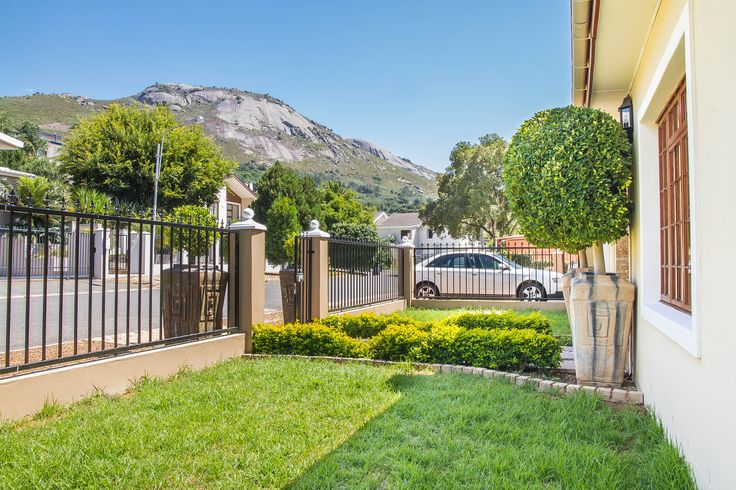 The front garden of this Paarl house with a stunning view of Paarl Mountain.