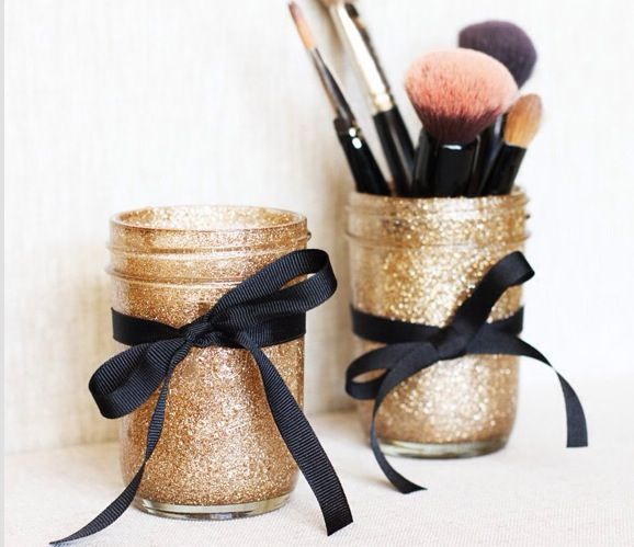Mason jars with gold glitter spray paint. Then just tie a black bow around it. Perfect for my dorm!