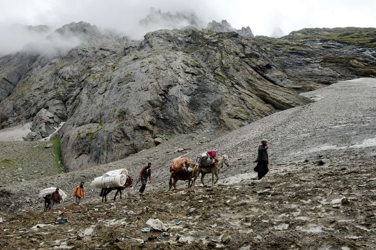 PILGRIMS: Kashmiris traveled near Amarnath Temple in Jammu, India, Sunday. Every year, hundreds of thousands of pilgrims trek through treacherous mountains in revolt-torn Kashmir, along icy streams, glacier-fed lakes and frozen passes, to reach the Amarnath cave. (Tauseef Mustafa/Agence France-Presse/Getty Image)