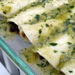 Black Bean Spinach Enchiladas with Roasted Tomatillo Sauce Recipe - CookEatShare.  This looks good, too. I think I'll get the ingredients to make this on the next shopping trip!