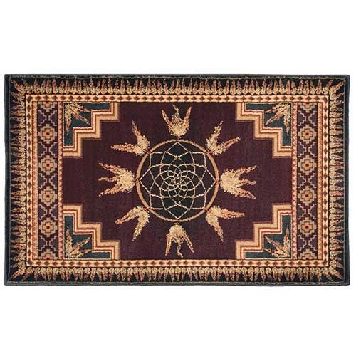 Pictured is the 30 inch x 50 inch Burgundy Dream Catcher Inspired Spirit Hearth Rug manufactured in America by Goods of the Woods.