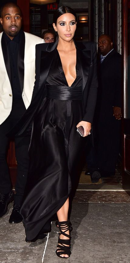 For a night out on the town, Kim Kardashian turned heads in dramatic plunging Balmain design, complete with a Balmain tuxedo jacket, and hubby Kanye West-designed heels