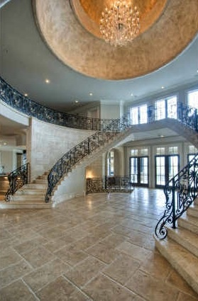 Twin marble staircases under huge dome...